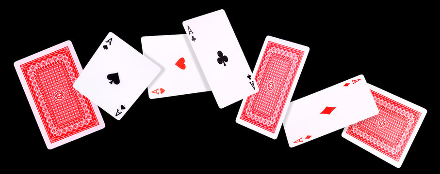 Flying playing cards for poker game on black background.