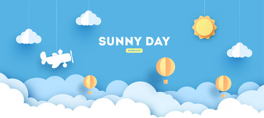 Cloudscape , blue sky with clouds and sun , paper art style. concept. paper cut design with balloons and airplane. Fotobehang