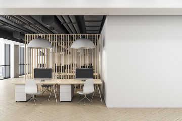 Minimalistic coworking office interior with blank wall