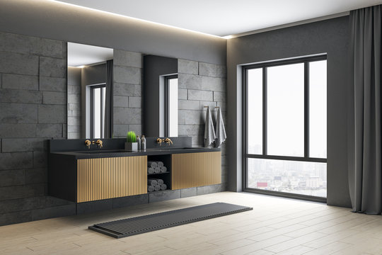 Modern gray bathroom with mirror, comfortable bathtub and city view.