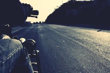 Fototapeta Cropped Image Of Man Riding Motorcycle On Road obraz