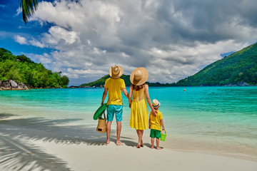 Wall Mural - Family with three year old boy on beach. Seychelles, Mahe, Port Launay.