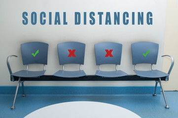 Blues chair alignment in a waiting room with symbol on seat for the social distancing during the Covid-19 pandemic