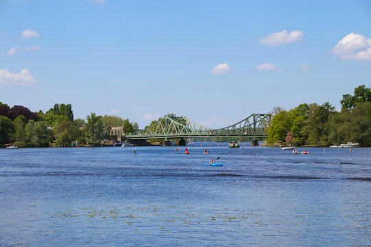 Beautiful view to the famous Glienicke Bridge (Glienicker Bruecke) across the havel river who connecting Berlin with  Brandenburg, Germany