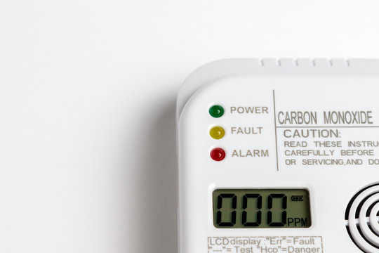 Carbon monoxide detector on a white wall. Stay home safe. Home control and security.  CO detector