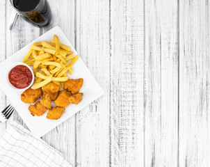 Vintage wooden table with fresh made Chicken Nuggets
