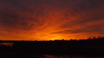 Foto auf Gartenposter Violett rot Silhouette Of Landscape At Sunset