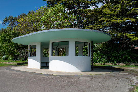 Littlehampton, West Sussex, UK, May 11, 2020, View of a beautiful Art Deco shelter next to a lake in Mewsbrook Park which was opened in 1939.