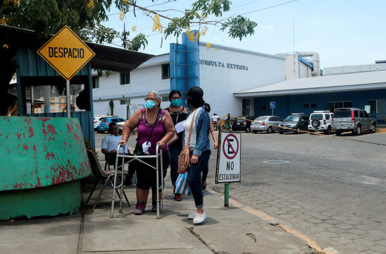 A patient walks with a relative after a consultation at the Aleman-Nicaraguense hospital, amid the outbreak of the coronavirus disease (COVID-19) in Managua