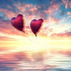 Wall Mural - romantischer Sonnenuntergang mit Herzballons