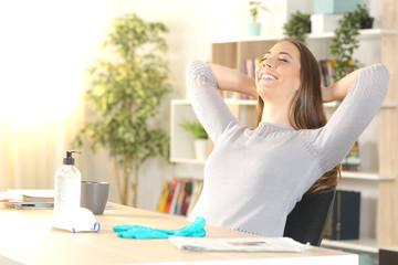 Happy girl breaths fresh air feeling safe of coronavirus at home