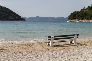 A bench is seen on a beach in Prapratno