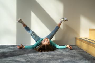 Cute kid lying on the floor and raising legs
