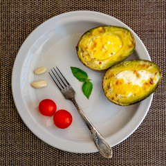 Avocado stuffed with eggs on the table.