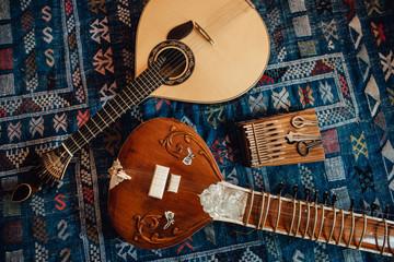 Traditional musical instruments: sitar, Portuguese guitar, kalimba