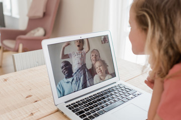 girl having a video call with her family at home