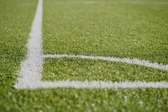 white line football corner on green field