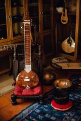 Traditional musical instruments, sitar, cimbalom, singing bowls