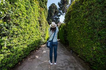 rear view of woman taking a picture in Italian garden