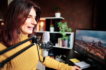 Woman podcasting at home with microphone and computers