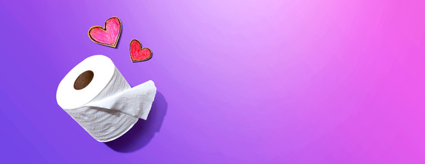 Toilet paper with hearts - overhead view flatlay