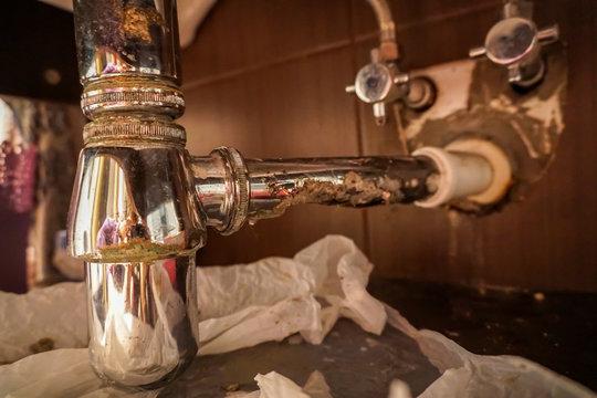 Broken leaking sink p trap