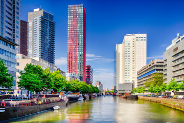 Foto auf AluDibond Rotterdam Central Part of Rotterdam City in the Netherlands with Water Canal and Lines of Barges Along Banks.