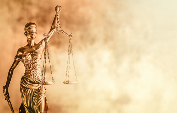 Scales of Justice brown background law concept image.