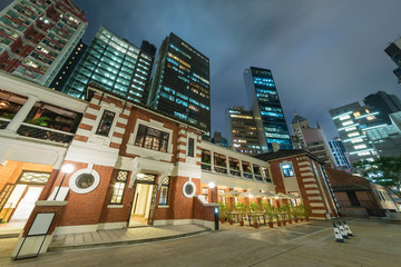 Fototapete - Old and new buildings in Hong Kong city