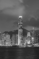Fototapete - Skyline of Victoria harbor of Hong Kong city at night