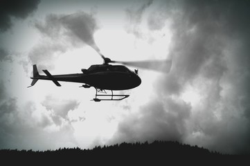 Wall Murals Helicopter Low Angle View Of Helicopter Above Mountain Peak