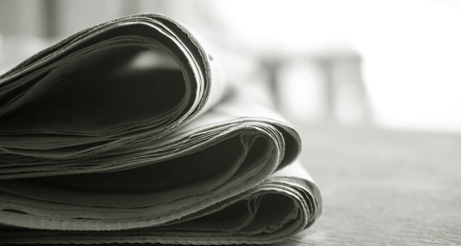 rolled up newspaper stack background