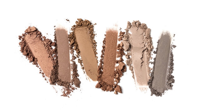 Close-up of make-up swatches. Smears of crushed brown and gray eye shadow