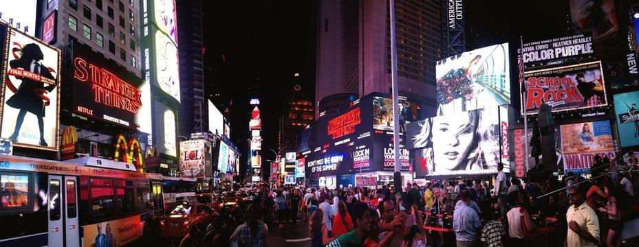 Crowd At Illuminated City Street At Night