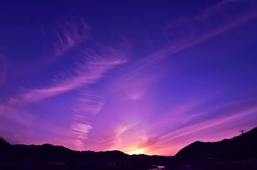 Foto auf Gartenposter Violett Moody Sky At Sunset