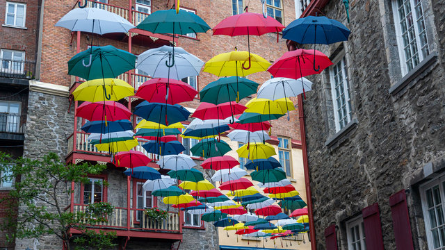 Famous place in the old Quebec City with umbrellas