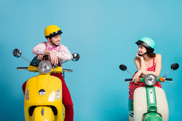 Portrait of his he her she nice attractive lovely cheerful cheery couple sitting on moped wearing festal look communicating isolated on bright vivid shine vibrant blue color background