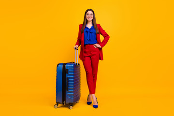 Fototapete - Full body photo of classy pretty business lady wait airport flight registration hold rolling case wear specs red luxury blazer blouse pants suit shoes isolated yellow color background