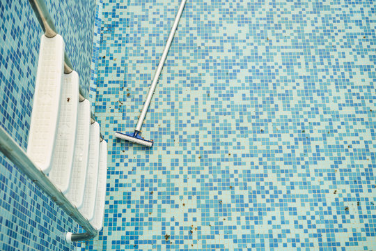 Empty swimming pool with metal ladder. Hotel coronavirus quarantine