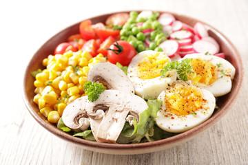 Foto op Aluminium Londen buddha bowl- vegetable salad with corn, tomato, radish and egg