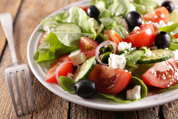 Fototapete - vegetable salad with cheese, onion tomato and olive