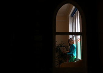 Director and founder of Poppy's Funerals, Poppy Mardall works on her laptop in her office in Lambeth Cemetery, as the spread of the coronavirus disease (COVID-19) continues in London