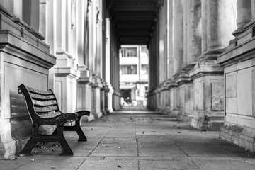 Acrylic Prints Old abandoned buildings Bench In Colonnade At Building