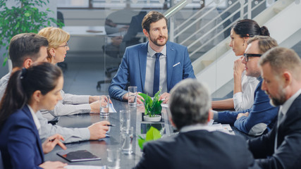 In the Modern Corporate Office Meeting Room: Diverse Group of Businesspeople, Lawyers, Executives and Members of the Board of Directors Talking, Negotiating and Working on a Winning Strategy.