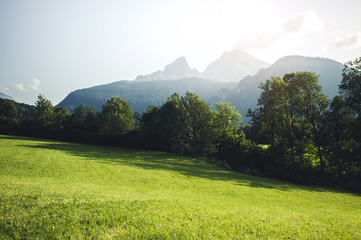 Wall Mural - Scenic view of green meadow and high mountains. Location place Berchtesgaden land, Germany alp.