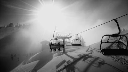 Fototapeten Grau Overhead Cable Cars At Snowed Landscape