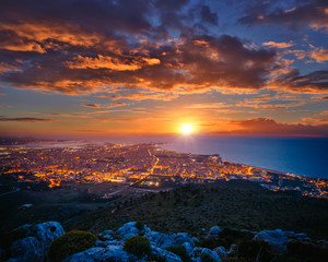 Wall Mural - Top view above the city illuminated with lights. Location Trapani town, Sicily, Italy, Europe.