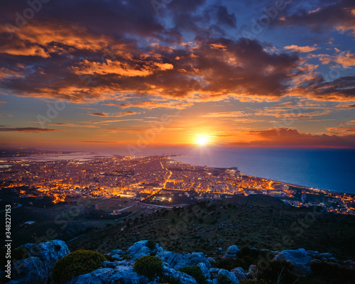 Wall mural Top view above the city illuminated with lights. Location Trapani town, Sicily, Italy, Europe.