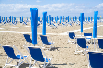 Empty beach, italy, mediteranean coast, symbolic for vacation restrictions due to coronavirus lockdown