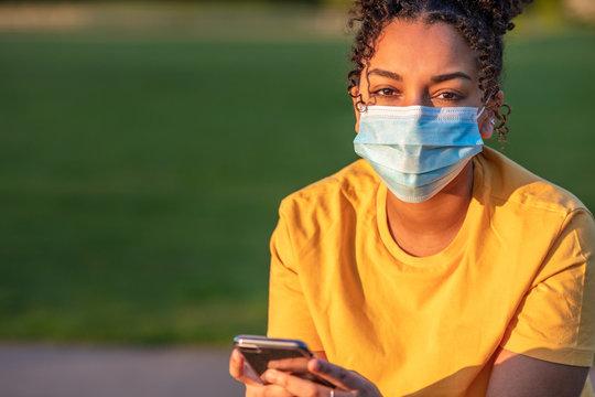 African American Biracial Teenager Girl Young Woman Wearing Coronavirus COVID-19 Face Mask